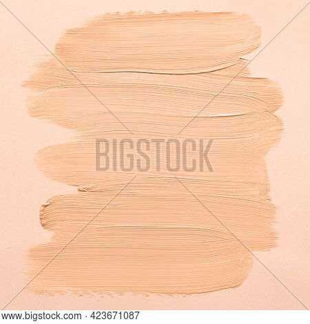 Liquid Make Up Base Swatch On Beige Background. Sample Of Cc, Bb Cream, Corrector Or Liquid Base Cre
