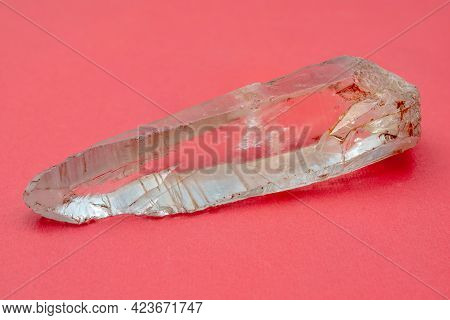 Mountain Quartz Crystal On A Pink Background. Mineralogy Object.