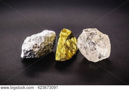 Rough Diamond Stone With Rough Nuggets Of Gold And Silver, Concept Of Gemstones And Minerology