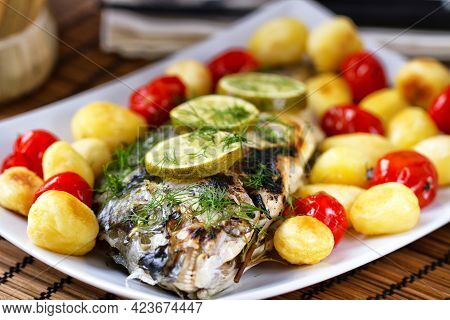 Baked Sea Bream With Baby Potatoes And Cherry Tomatoes