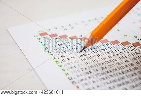 Modern Astrologer's Desktop. Yellow Pencil. Astrological Charts And Tables With The Coordinates Of T