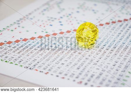 Modern Astrologer's Desktop. Thoughts Of An Astrologer. Yellow Glass Pebble On The Table. Astrologic