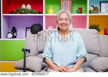 Asian Elderly Woman Happy Smile She Is In Good Health Sit On The Sofa In The House. Concept Of Healt