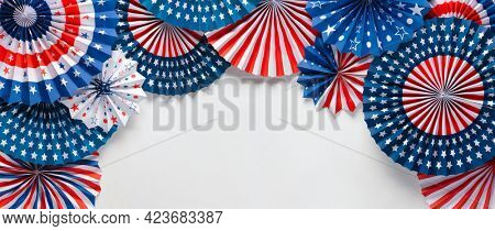 Vibrant red white and blue paper fans with copy space for text. For 4th of July, Memorial day, Veteran's day, or other patriotic holiday celebrations.