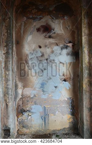 A Concrete Wall Destroyed By Time. A Wall With Traces Of Destruction.crumbling Plaster. Architectura