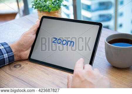 Alanya, Turkey - May 14, 2021: Man Hands Hold Apple Ipad Air Space Gray With Calling Zoom Video Comm