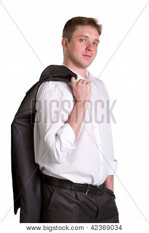 Happy Young Businessman With Jacket On Shoulder And Hand In Pocket Posing And Smiling