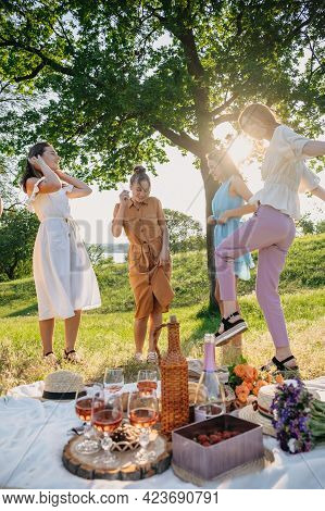 Summer Party, Outdoor Gathering With Friends. Five Young Women, Friends At The Picnic Dancing And Ha