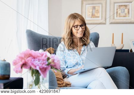 Attractive Middle Aged Businesswoman Working From Home