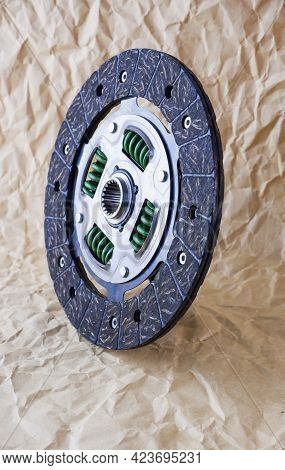 Car Parts. Car Clutch Disc. Photo Of A New Clutch Disc Before Installation On A Car Against A Backgr