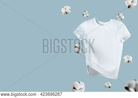 White Flying Cotton T-shirt Isolated On Blue Background. Clean White T-shirt For Women Or Men. Unise