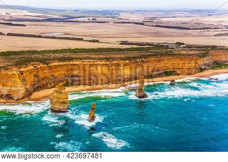 Australia. The Twelve Apostles and Great Ocean Road. Gorgeous Ocean Turquoise Surf. Picture taken from a helicopter. The concept of extreme, active and photo tourism