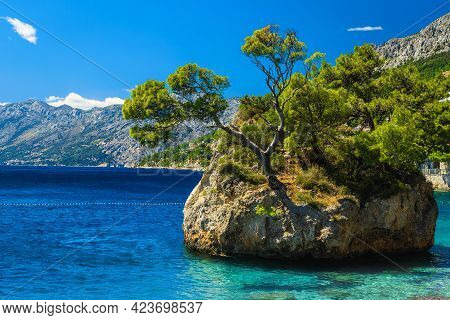 Wonderful Scenery With Clean Sea And Famous Rock Island In The Adriatic Sea. One Of The Best Famous
