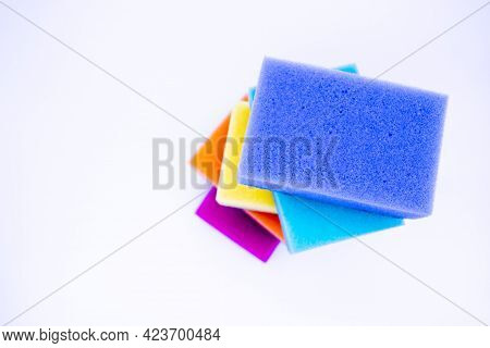 Top View Of Sponges For Washing Dishes, On A White Background, Isolated. Colorful Multi-colored As R