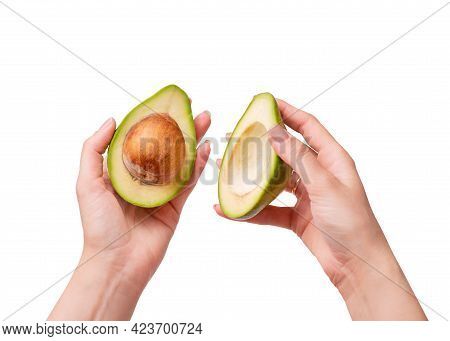 Sliced Avocado Fruit In Female Hands. Avocado Isolate On A White Background. Two Pieces Of Avocado C