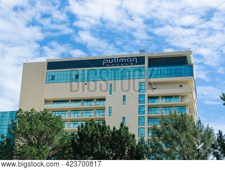 Sochi, Russia - June 9, 2021 Pullman Hotels Building In Sochi. Hotel Logo On The Roof Of The Buildin