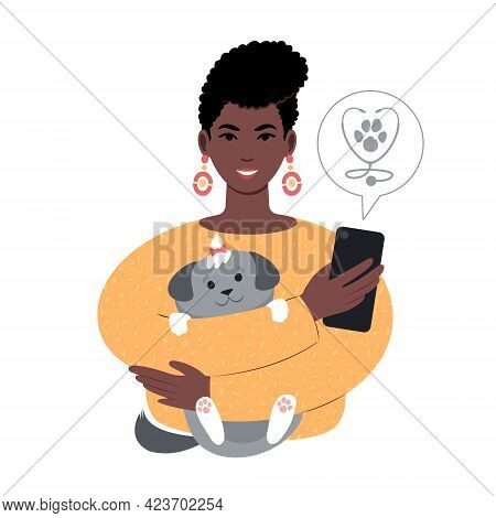 Young African Woman With A Tiny Dog Searching For Veterinarian Online From Smartphone.