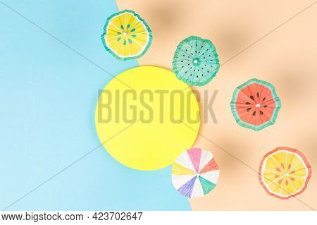 Creative Paper Craft Of Many Sunshade Umbrellas On A Paper Sandy Beach. Summer Vacation Concept. Sum
