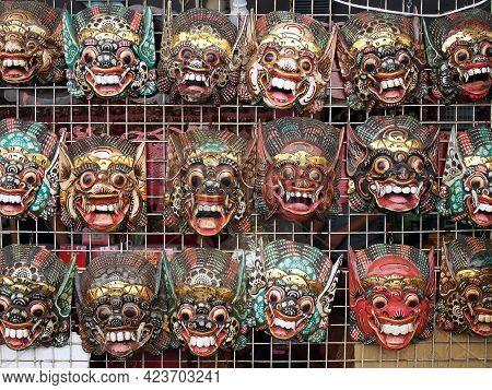 Bangkok, Thailand - January 16, 2020 : Close Up Row Of Colorful Wooden Carving Giant Masks Hanging O