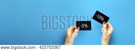 Discount Card In Hand. Discount On Purchases 5 , 10 , Percent . A Woman Is Holding A Black Discount