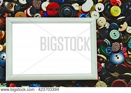 Blank Frame And Place For Text On Tailor Buttons Background. A Rigid Structure That Surrounds Or Enc