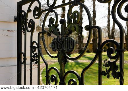 Close Up Of An Old Metal Fence With Decorations