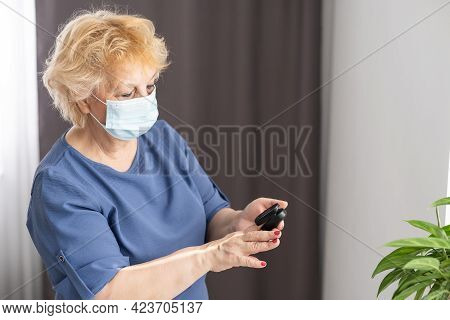 Assessment Of The Respiratory System Function. Measurement Of Blood Saturation And Pulse In An Elder