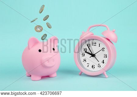 Time, Savings, Time Is Money. Pink Piggy Bank Piggy Bank With Falling Coins And Alarm Clock, Concept