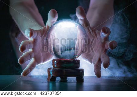 Magician Or Fortune Teller Is Predicting Future With Crystal Sphere.