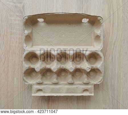 Cardboard Egg Box. Empty Egg Carton. Eggs Box. Empty Box Of 10 Eggs On A Wooden Table