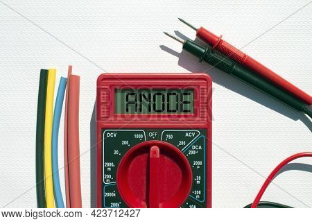 Multimeter With Text On Display Anode And Heat Shrink Insulation On White Background. Construction A