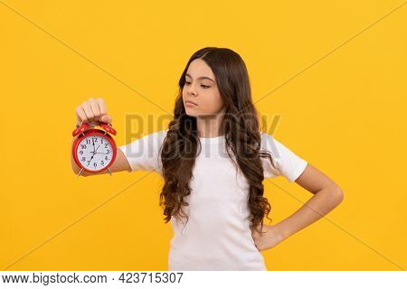 Serious Kid Hold Retro Alarm Clock Showing Time, Punctual