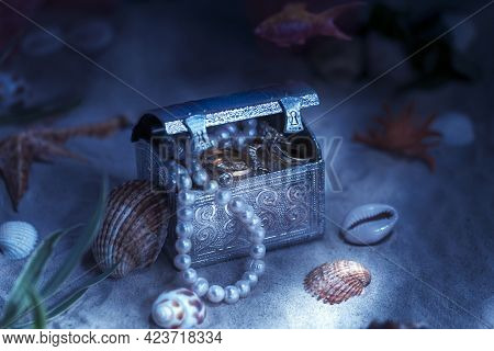 Fantasy On The Theme Of Treasures Lying On The Bottom Of The Sea Or Ocean. Jewelry Lying In A Chest