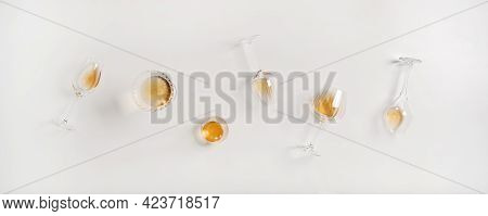 Flat-lay Of Trendy Orange Or Amber Wine In Different Glasses