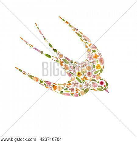 Art floral swallow spring symbol made of beautiful natural flowers. Trendy colorful blooming abstract idea with bird shape composition. Botany concept with leaves, blossoms, petals  and buds