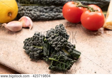 Cooking With Black Flat Leaves Of Cavolo Nero Tuscan Cabbage