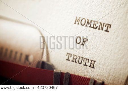 Moment of truth phrase written with a typewriter.