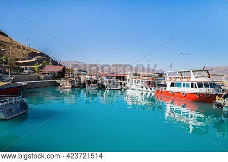 Bay With Tourist Boats Near Akdamar Island On Van Lake, Gevaş, Turkey. Lake & Island Are Popular Tou