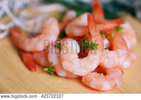 Shrimp Peeled On White Wooden Ready For Cooking, Fresh Shrimps Or Prawns Seafood And Shellfish Boile