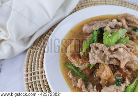 Fried Noodle With Pork And Kale In Gravy. Chinese And Thai Style Food Called \
