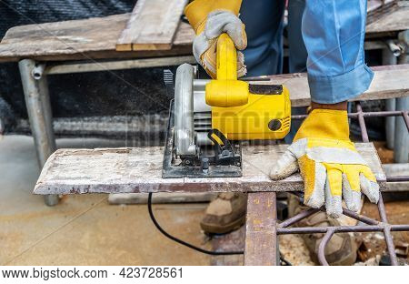 Carpenter Using Circular Saw For Cutting Wooden Boards With Power Tools, Construction And Home Renov
