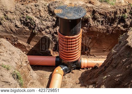 Sewage System. Plastic Tubes And Aka. Excavated Trench Or Pit