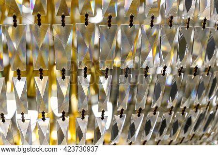 Close Up Detail Of Large Golden Chandelier Background.