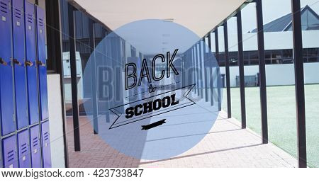Composition of text back to school in black on blue circle and school corridor background. school, education and study concept digitally generated image.