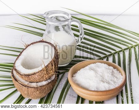 Coconut Milk With Coconut Shavings And Broken Coconut On Palm Leaf