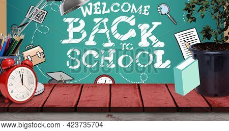 Composition of welcome back to school in white on chalkboard with alarm clock and school equipment. school, education and study concept digitally generated image.