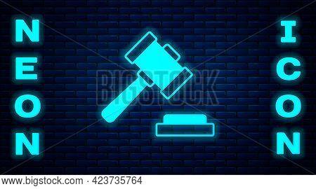Glowing Neon Judge Gavel Icon Isolated On Brick Wall Background. Gavel For Adjudication Of Sentences