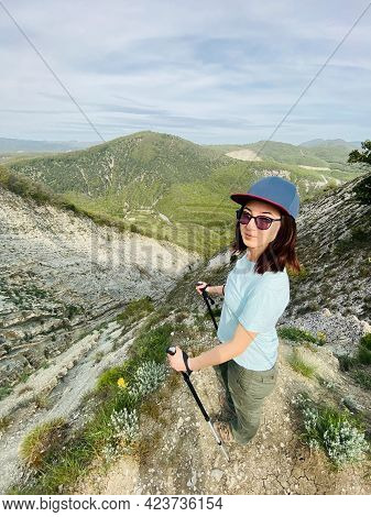 Woman Hiker In The Mountains Is Photographed At A Hyper Wide Angle