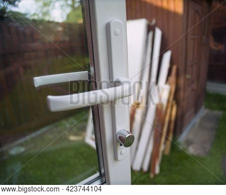 Just Replaced New Pvc Composite Door, Parts Of Old Door Abandoned In The Blurred Background
