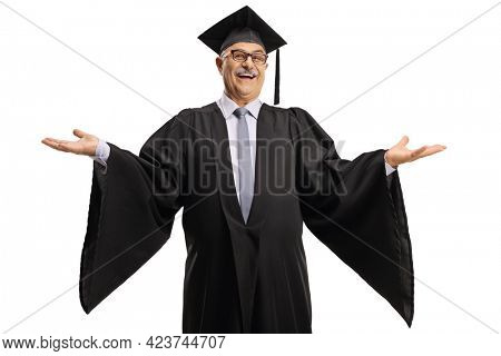 Cheerful mature man wearing a graduation gown and spreading arms isolated on white background